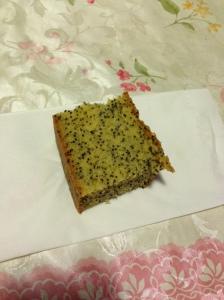Cut up piece of Moist orange poppy seed cake. Made by Helen