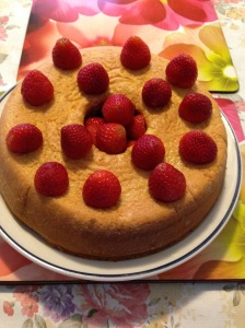 After remove from pan glazed it with orange juice and decorate with strawberries.