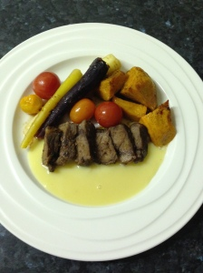 porterhousesteak, pumpkin, carrot mix roast with tomatoes medley serve in white choco sauce
