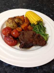 Roasted beef fillet, pumpkin, tomatoes, potatoes, brocollini and corn