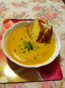 Carrot and orange soup serve w croissant and asparagus