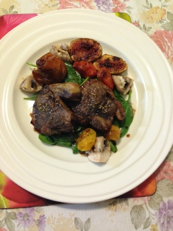 Lamb loin chop w baked tomatoes medley, figs on a bed of spinach and mushrooms.JPG