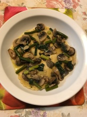 Aged prosciutto ricotta basil cappeletti with leek leaves garlic sticks and mushrooms sauce.JPG