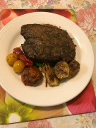 Orange rosemary rump with roasted cherries and Brussel sprouts on a bed of mixed salads.JPG