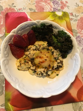 Mushroom, spring onion,chili flakes cloud cured egg served with blackouts kale chips and strawberries .JPG