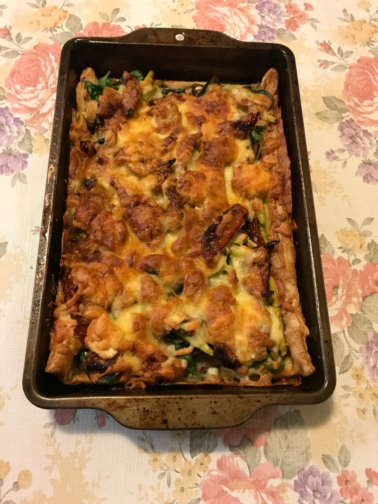 Garlic sticks and Parmesan tart with spinach mushrooms and sundried tomatoes.JPG