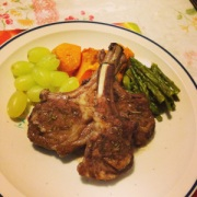Spiced lamb racks with grapes and vegetables