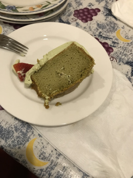 Matcha Chiffon cake with matcha cream and berries cut up.JPG