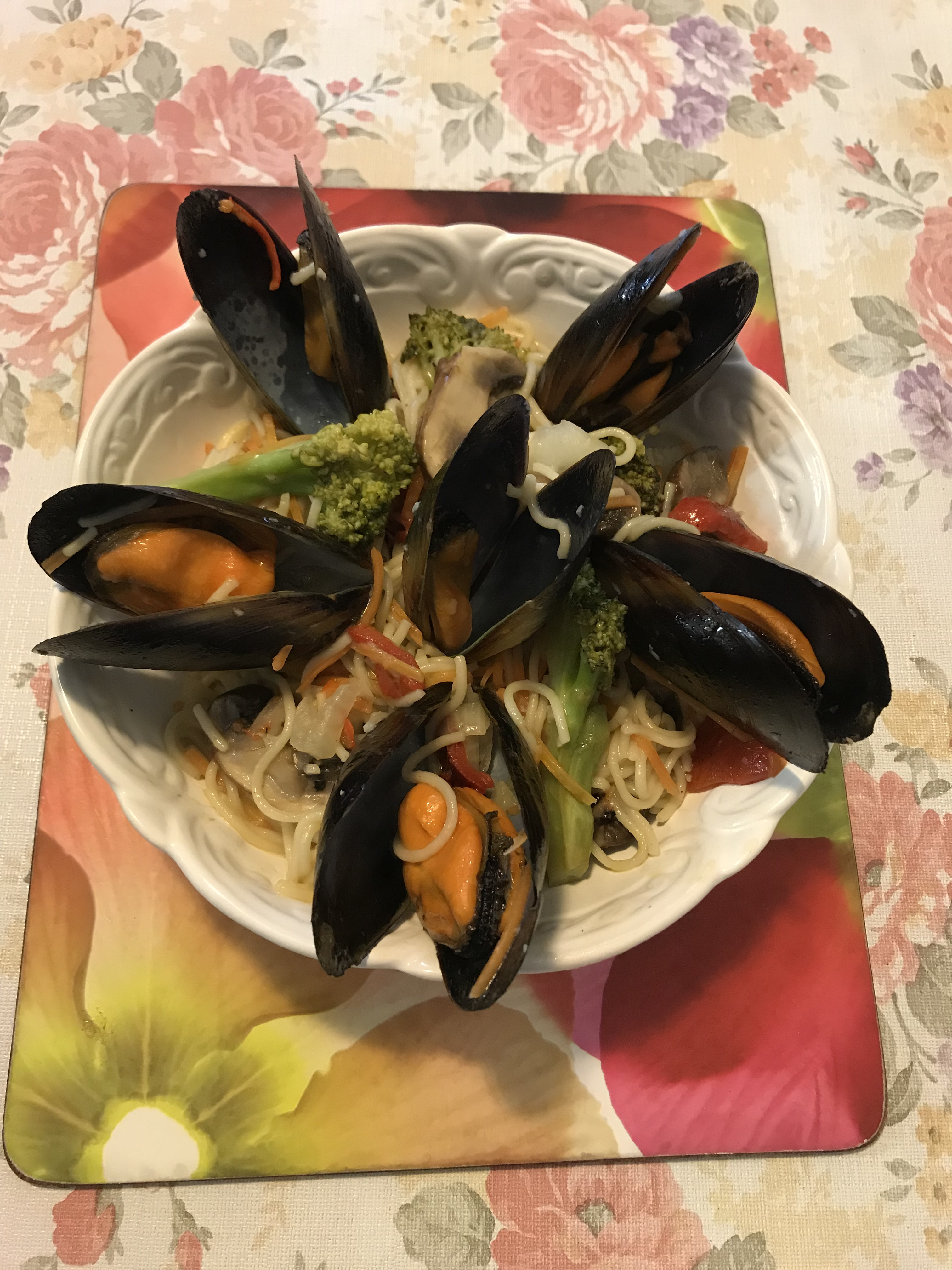 Egg noodles pasta mussels and vegetables in butter and white wine sauce.jpg