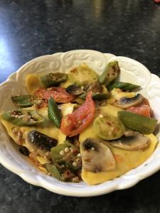Porcini mushrooms & truffle triangolis with mushrooms okra in crispy prawns chilli sauce