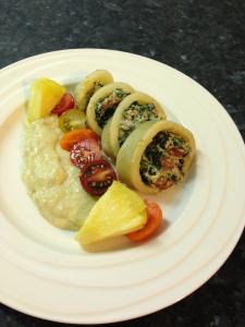 Stuffed calamari, puree fennel &potatoes serve with tomatoes medley