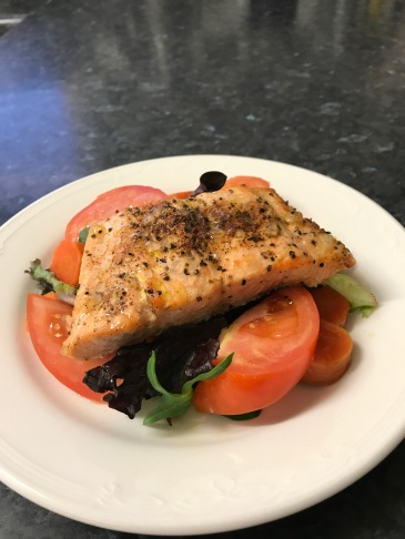 Grill salmon on a bed of salad with boiled carrots