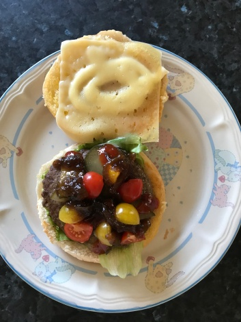 Beef burger caramilsed onion medley tomatoes with cheese and mayo.JPG